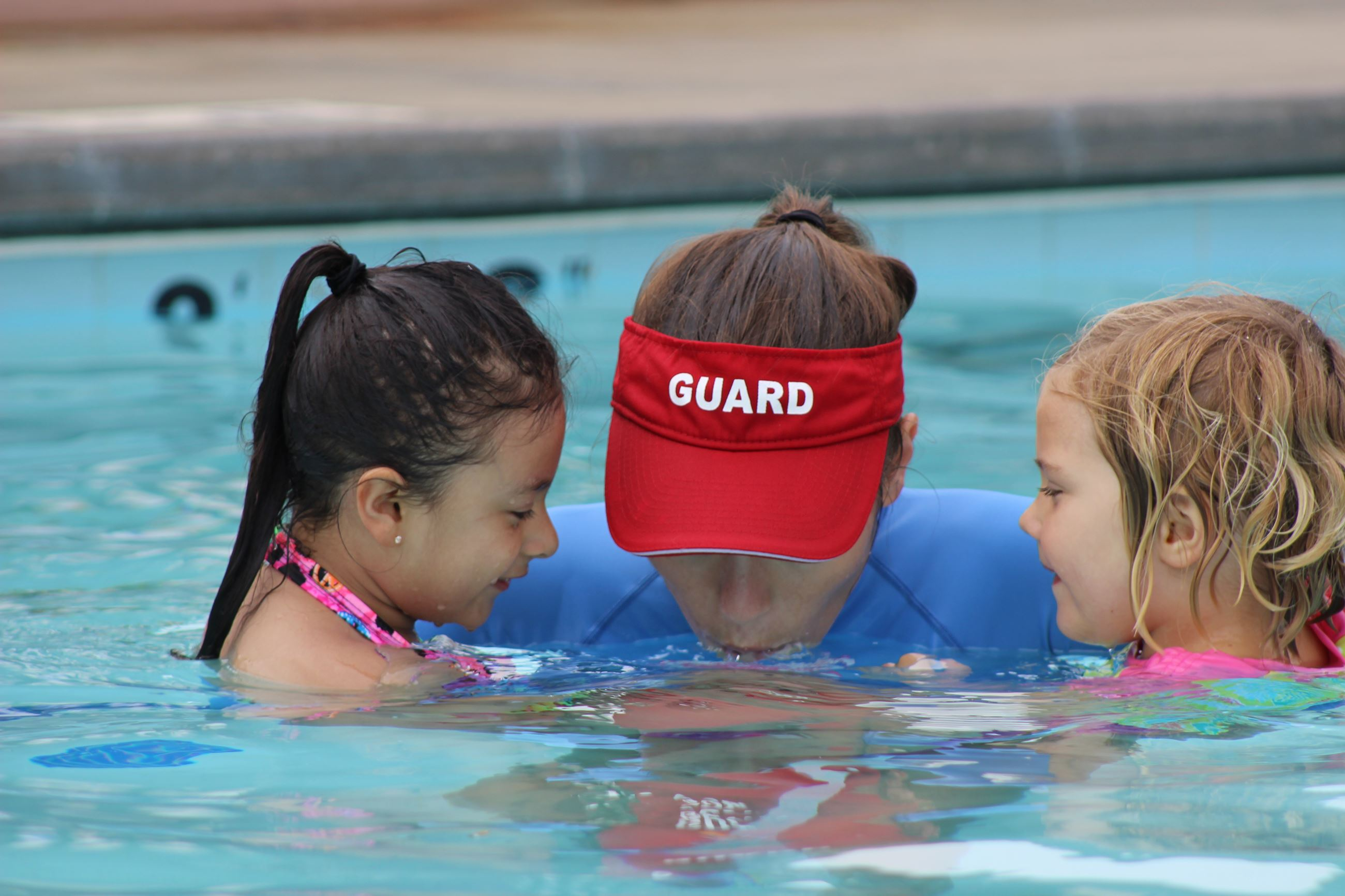 kids and lifeguard in pool