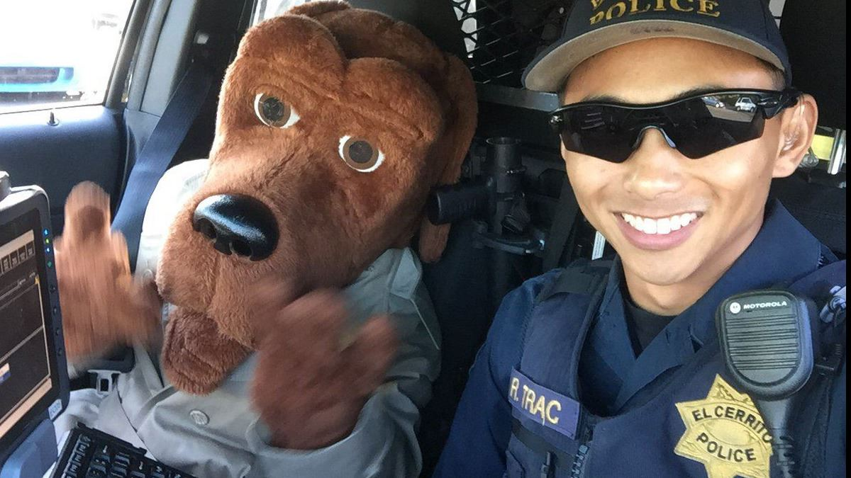 NNO McGruff with officer in patrol car