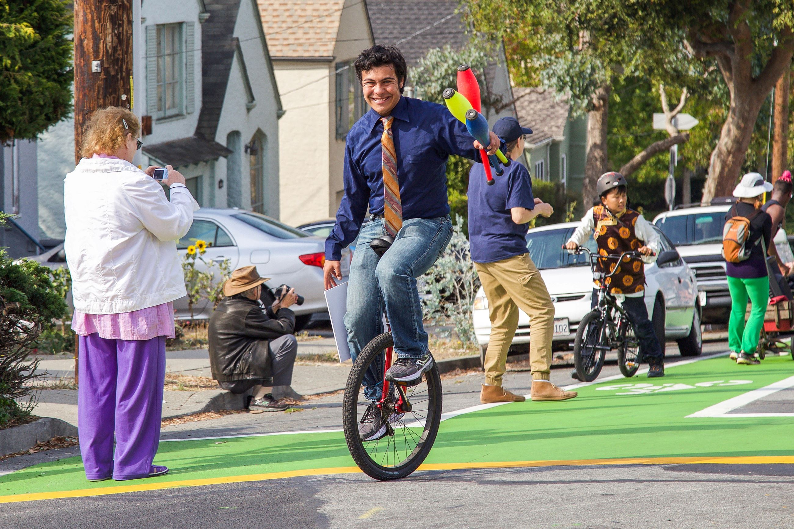 229 Magical Nathaniel on unicycle - Photo by Marin Stuart
