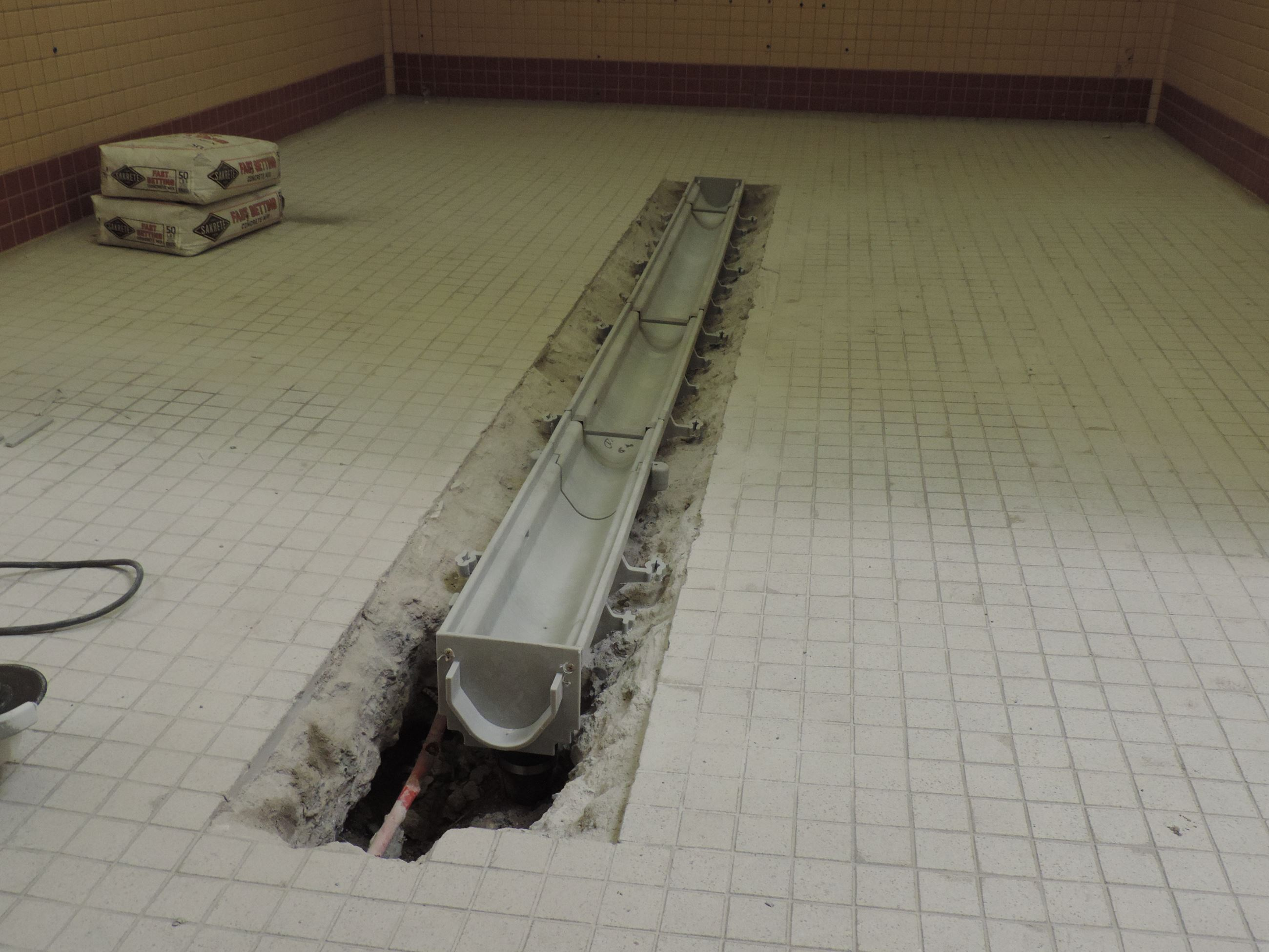 New Plastic Trench Drain Installed (Women's Changing Stalls)