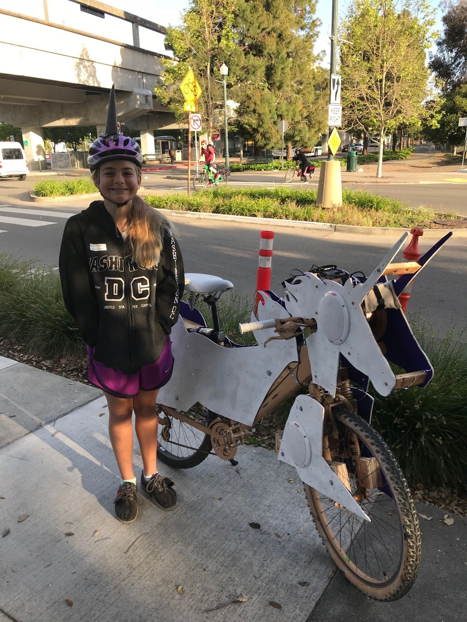 Girl with unicorn modified bike and helmet at Bike to Work Day 2018