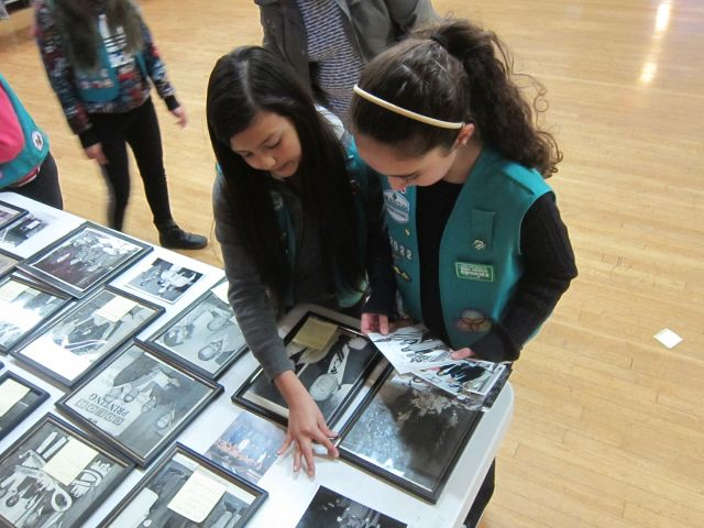 Girl scouts help set up historic photos at Chamber of Commerce and Historical Society event